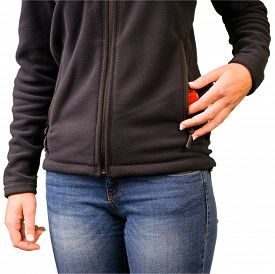 image of shoplifting  - Young woman puts nail varnish in her vest - JPG