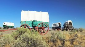 image of wagon  - A covered wagon train forms a protective circle to camp along the Oregon Trail in eastern Oregon - JPG