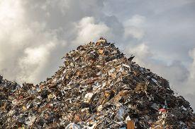 picture of scrap-iron  - heap of scrap iron against dramatic sky - JPG