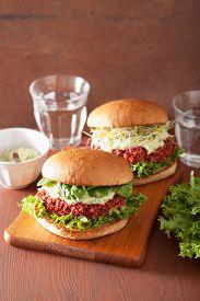 picture of veggie burger  - veggie beet and quinoa burger with avocado dressing - JPG