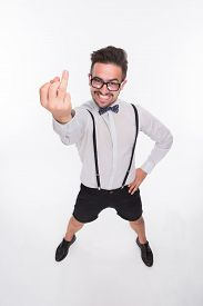 picture of middle finger  - Top view of smiling man in glasses showing middle finger islated on white background - JPG