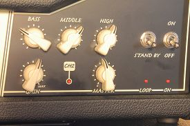 stock photo of levers  - Grey control panel of the amplifier with levers - JPG