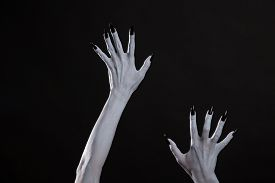 foto of pale skin  - Pale ghost or witch hands with sharp black nails - JPG