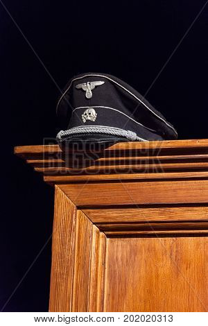 Nazi Cap Exhibited On Wooden