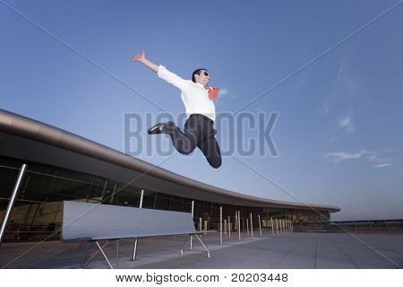 Energetic screaming business person enjoying to jump from bench symbolizing success or fun in business.