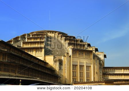 View of central market from angle showing dome against clear blue sky,Phnom Penh,Cambodia