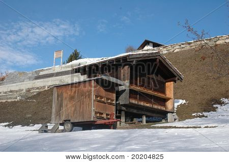 wooden bee house in the swiss alps around christmas time