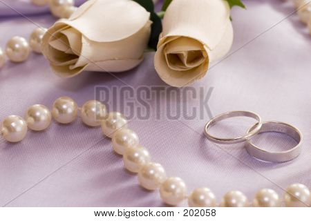 Roses And Wedding Rings