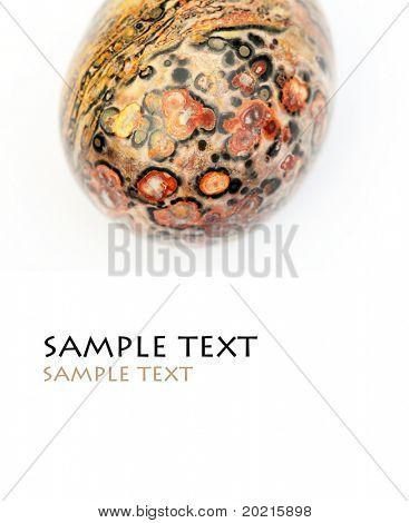 close-up of a beautiful precious stone against white background