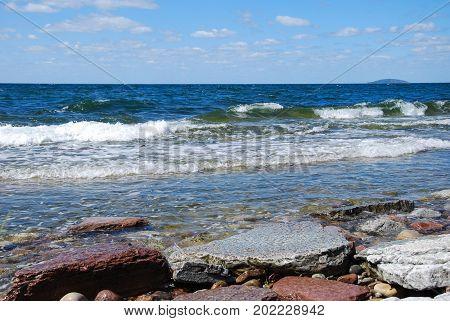 Colorful coastline with flat rocks at the swedish island Oland in the Baltic Sea