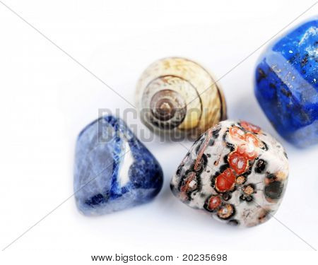 beautiful precious stones against white background
