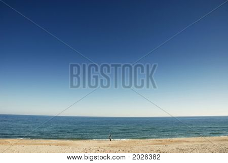 Small Boy, Outstretched Arms On Beach