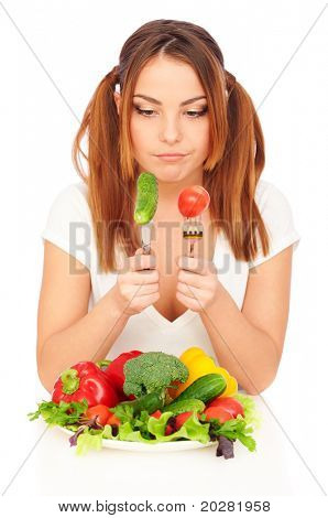 sceptical woman looking on fresh vegetables. isolated on white background
