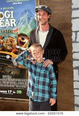 LOS ANGELES - DEC 11:  Noah Wyle & Son arrives to the 'Yogi Bear' Los Angeles Premiere  on December 11, 2010 in Westwood, CA