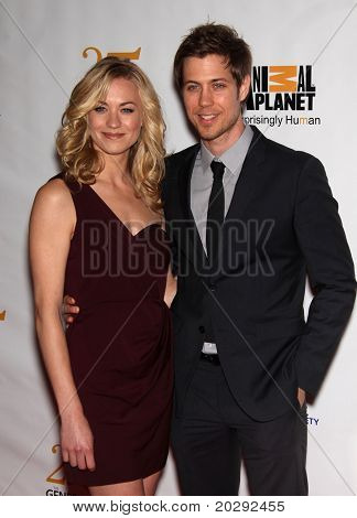 LOS ANGELES - MAR 19:  Yvonne Strahovski & guest arrive to the 25th Annual Genesis Awards  on March 19, 2011 in Century City, CA