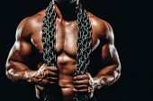 Strong Athletic Bodybuilder With Metalic Chain,six Pack, Perfect Abs, Shoulders, Biceps, And Triceps poster