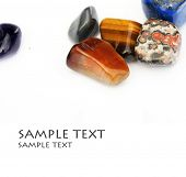 stock photo of lapis lazuli  - a collection of beautiful precious stones against white background - JPG