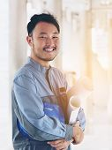Portrait Of Happy Asian Engineer poster