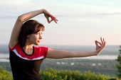 foto of tai-chi  - young beautiful girl have some exercises in the meadow - JPG