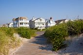 stock photo of beach-house  - Beach Houses on the New Jersey shore through the sand dunes - JPG