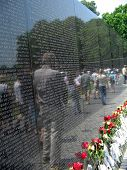 Vietnam War Memorial With Reflection Of Visitors poster