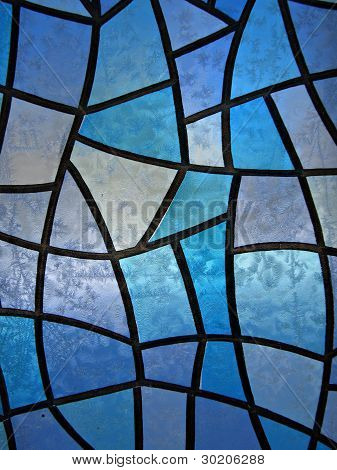 Stained glass background with ice flowers