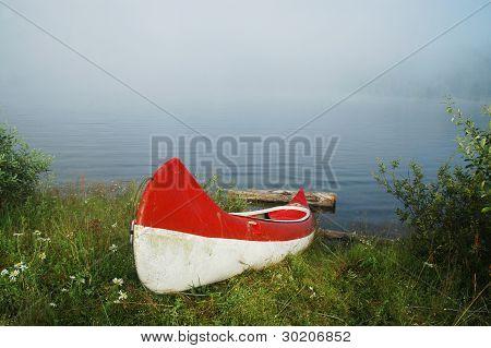 Canoe near a lake in morning lights