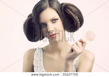 Vintage Girl With Lollipop. She Looks In To The Lens