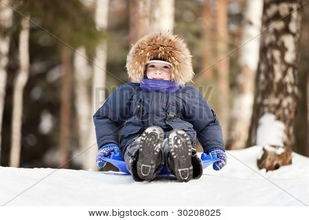 Child Sled On Snow Hill