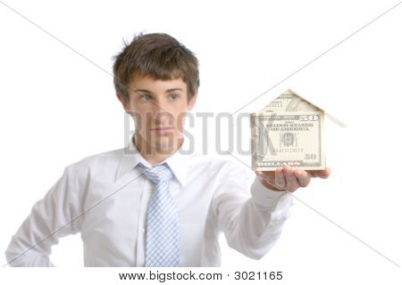 Business Man Holding A House Made Of Money