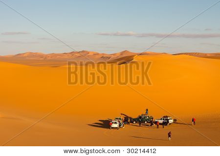 Tourists In The Sand Sea Of The Sahara Desert