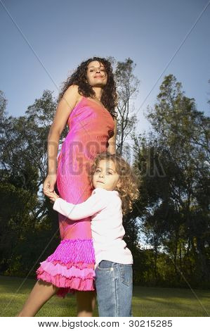 Mother and daughter dancing outdoors