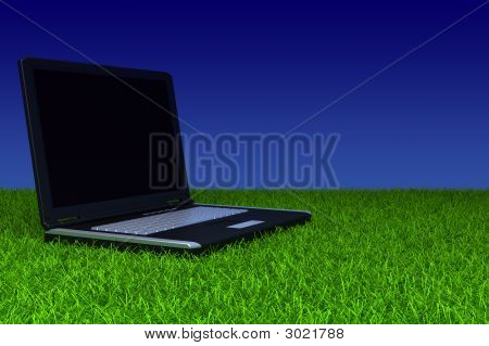 Laptop With Blank Screen On Grass