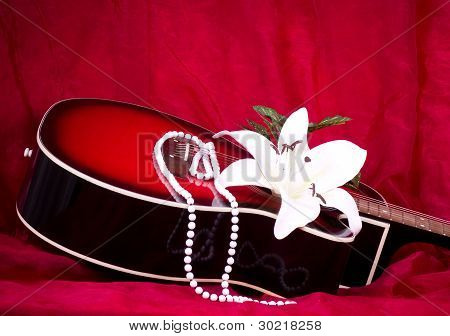 Beautiful red guitar with white Lily and beads