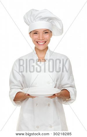 Chef showing empty plate. Woman cook or chef serving empty plate smiling happy isolated on white background. Young multiracial female chef.