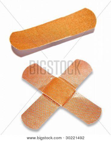 Medical plaster dressings on plain background