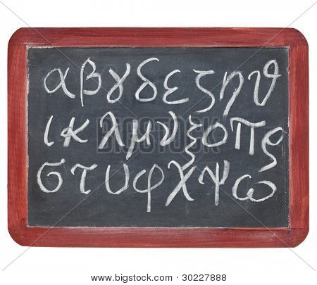 Greek alphabet from alpha to omega - white chalk handwriting on a small slate blackboard