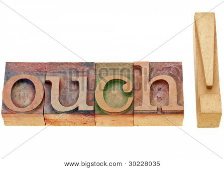 pain or surprise concept - ouch - isolated exclamation word in vintage wood letterpress printing blocks