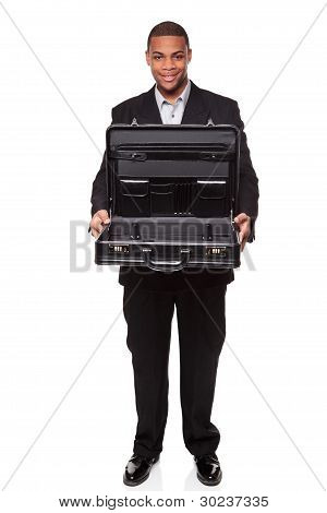 Smiling African American Businessman Isolated On White Holding Open Briefcase