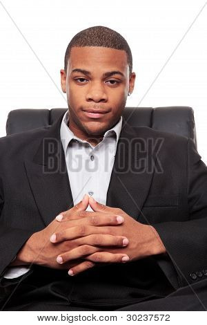 Young African American Businessman Relaxing In Chair