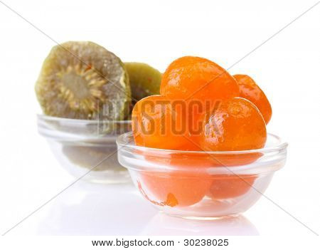 Dried tangerines and kiwi in bowls isolated on white