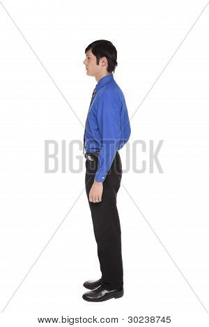 Caucasian Businessman Standing With Arms At Sides Side View