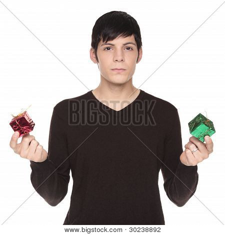 Caucasian Man Comparing Green Present To Red