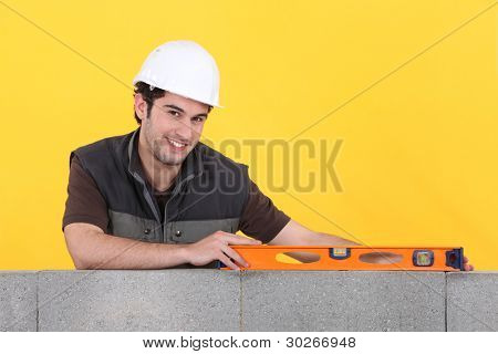 craftsman working with a level
