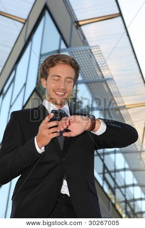Man checking his watch against his cellphone