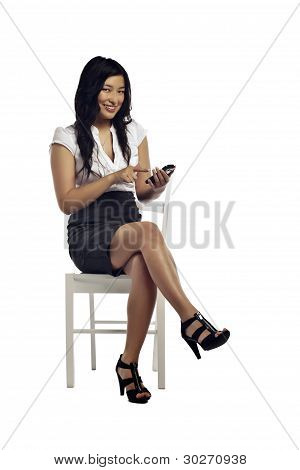 Asian Business Woman Reading Text Received On Her Mobile
