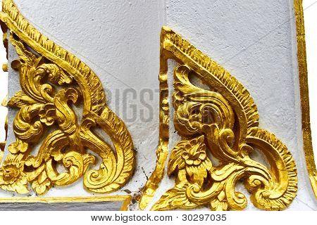 Golden Thai pattern design on temple wall