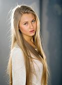 stock photo of natural blonde  - Beautiful girl with highlighted hair looks from behind the camera - JPG