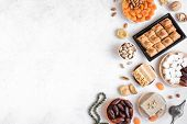 Assortment, Set Of Eastern, Arabic, Turkish Sweets, Nuts And Dried Fruits On White Table, Top View,  poster