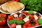 image of greek food  - Greek salad with tomatos mozzarella cheese onions olives - JPG